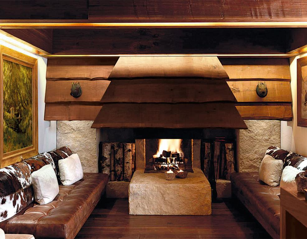 Spacious fireplace with stone structure and wood outer