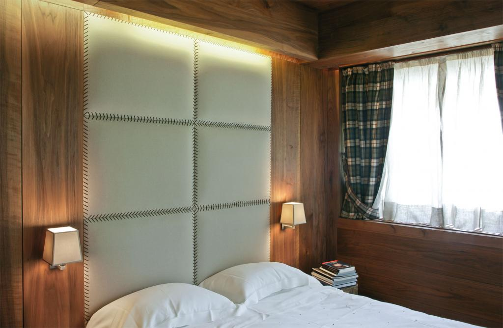 Full height paneling with upholstered inserts