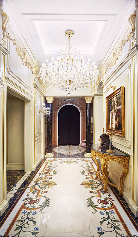 Corridor with polychrome inlaid marble floor and plaster decorated ceiling