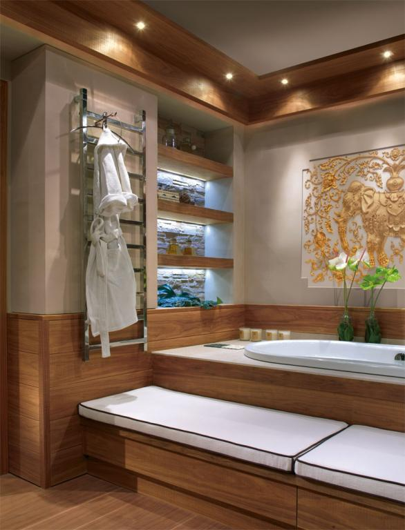 A spacious in built bath tub with sawn Canaletto walnut exterior