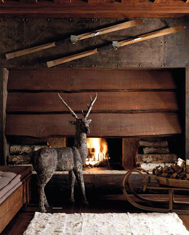 Detail of the spacious wood and iron fireplace