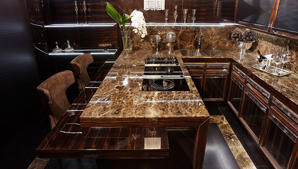 Polished marble top with integrated cooking units