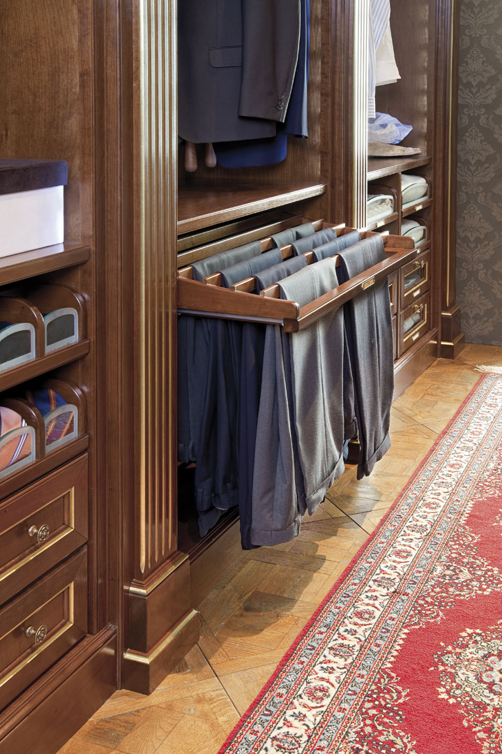 Pull-out power assisted trouser rack