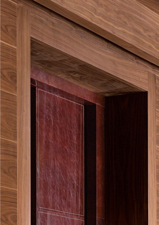 Detail of the paneling surrounding the leather upholstered door