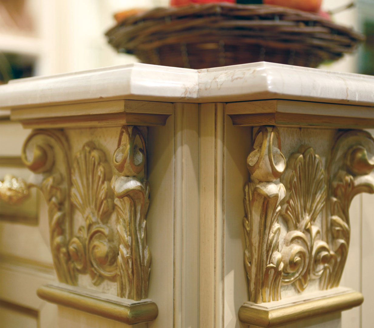 Marble top, hand carved capitals and pilasters decorated with gold foil