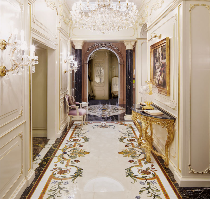Corridor with lacquered ivory boiserie and gold leaf decorations