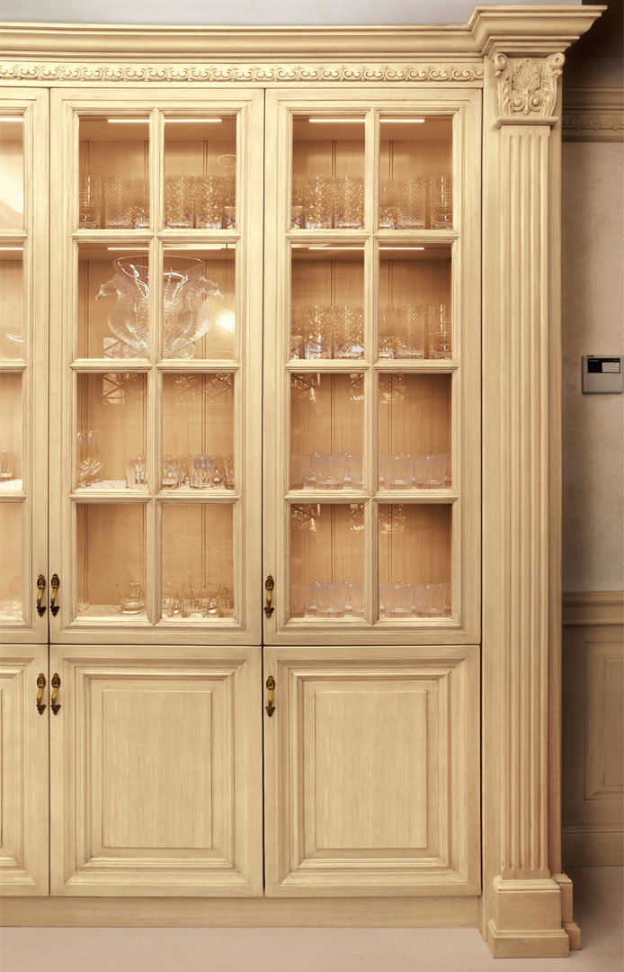 The glass cabinet displays and protects your most precious objects
