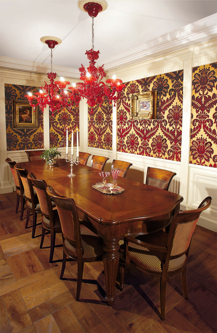 A spacious cherry dining table complete with matching chairs