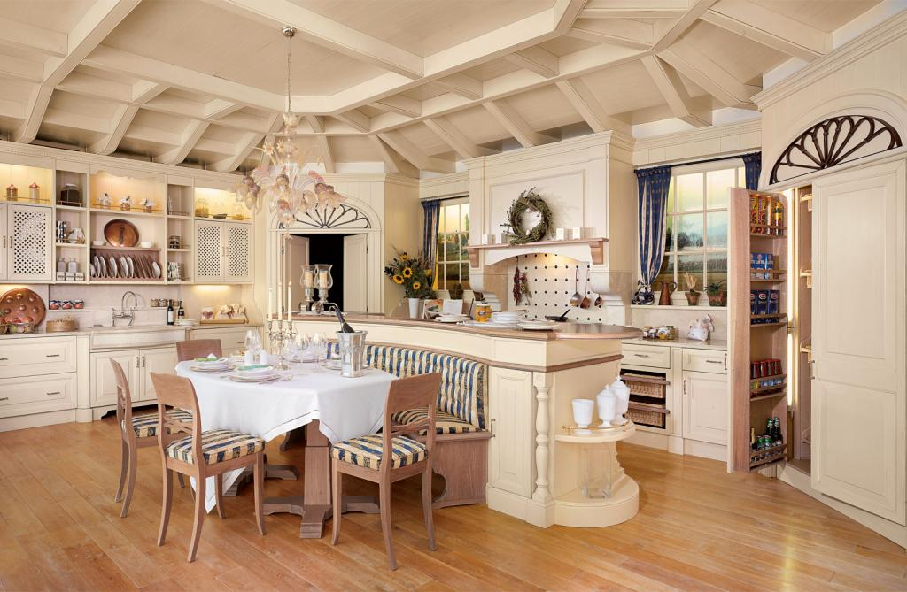 The kitchen comprises a wide central island which surrounds the master table