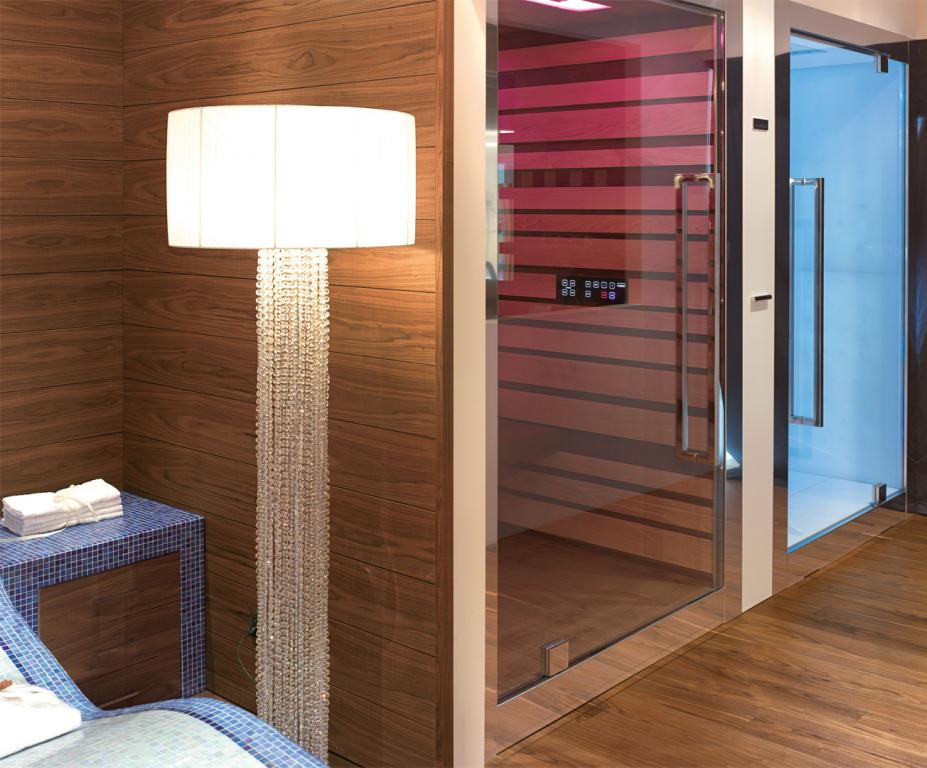 Full height paneling surrounds the sauna and Turkish bath cabins