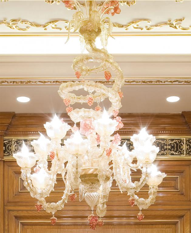 Handmade lamps made by the best Venetian glass blowers, in a stucco ceiling decorated with golden friezes.