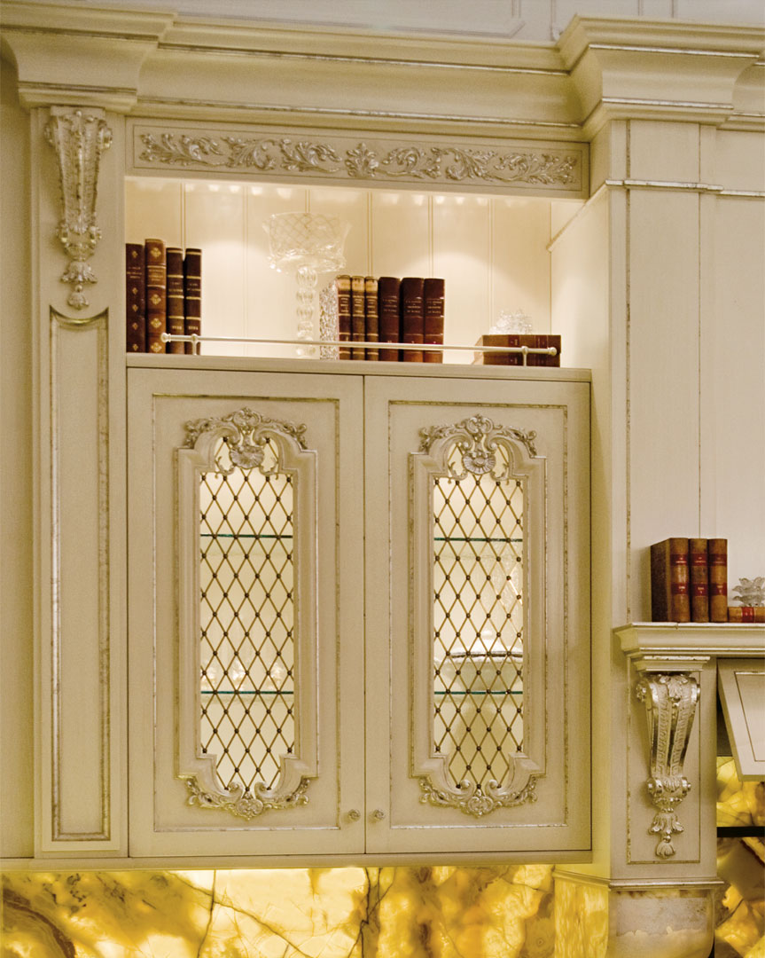 Glass doors with chiseled antiqued brass grating