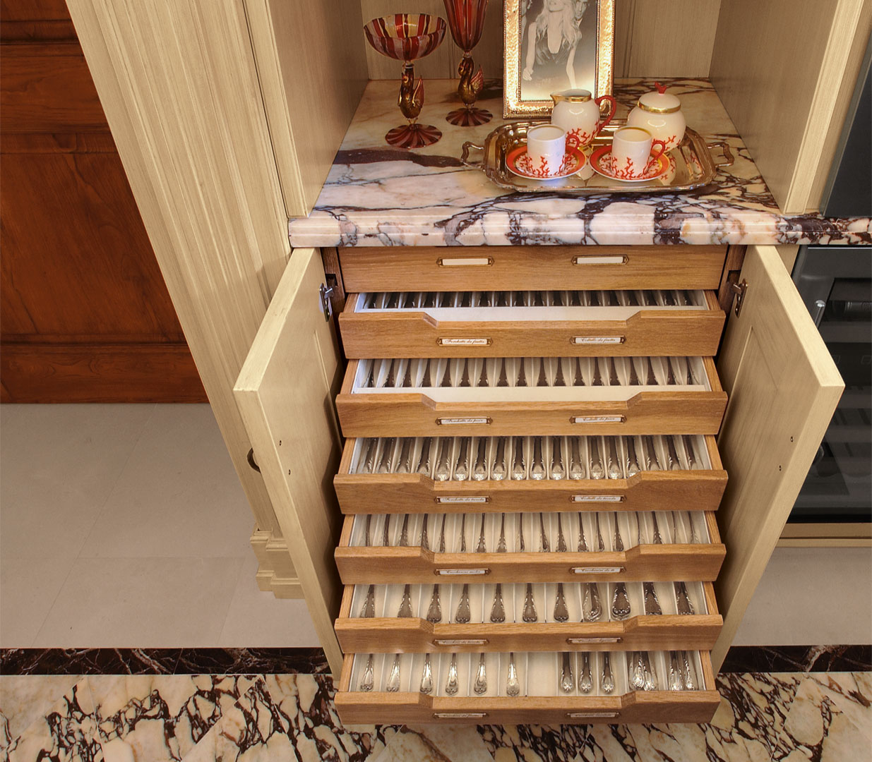 The dining service is stored in fabric lined drawers
