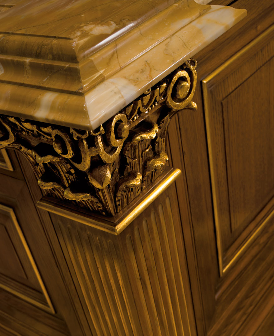 Thick Siena yellow marble top, hand crafted capitals and details decorated with gold foil