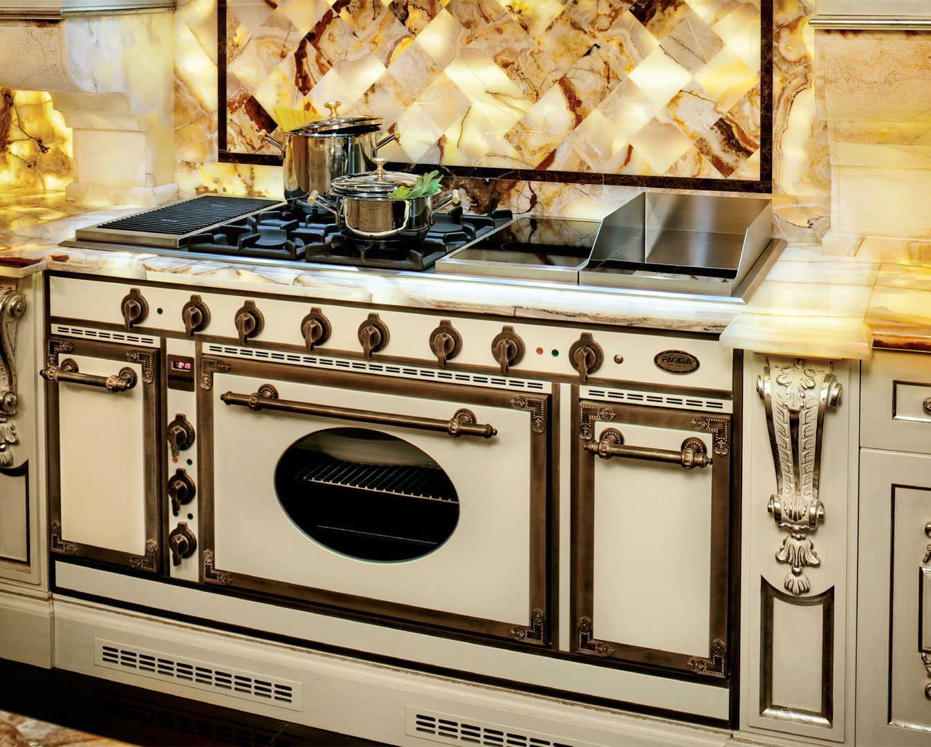 Inbuilt and custom made cooker complete with antiqued brass profiles and buttons