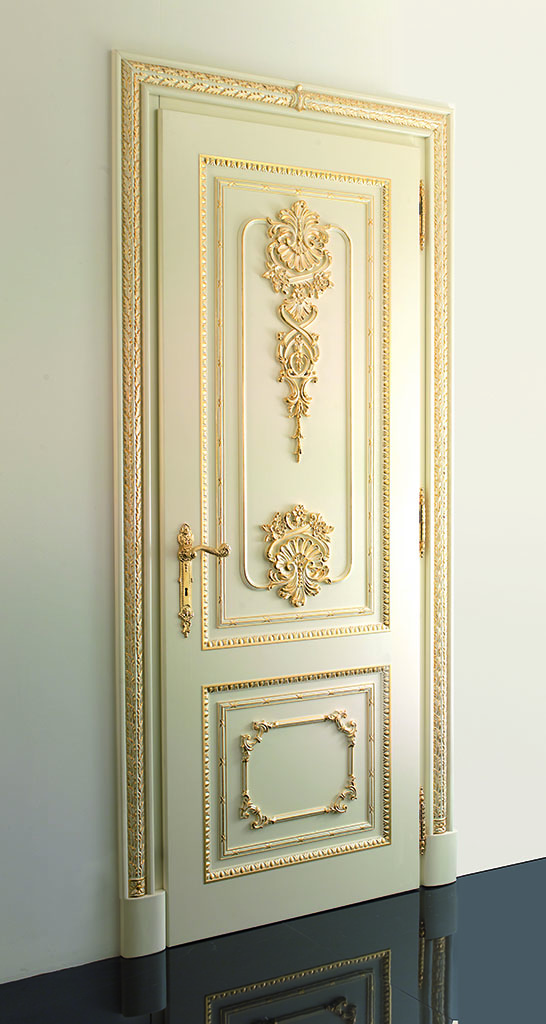 Hinged door with side frames is ivory lacquered and embellished with gold leaf decorations.