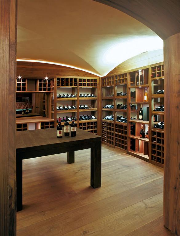 A wine cellar furnished exclusively with solid Canaletto walnut.
