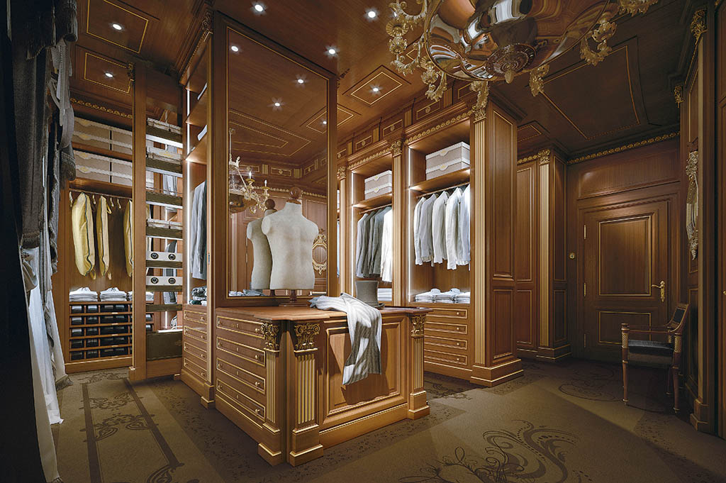 Prestigious wardrobe in cherry wood with gold leaf decorations.