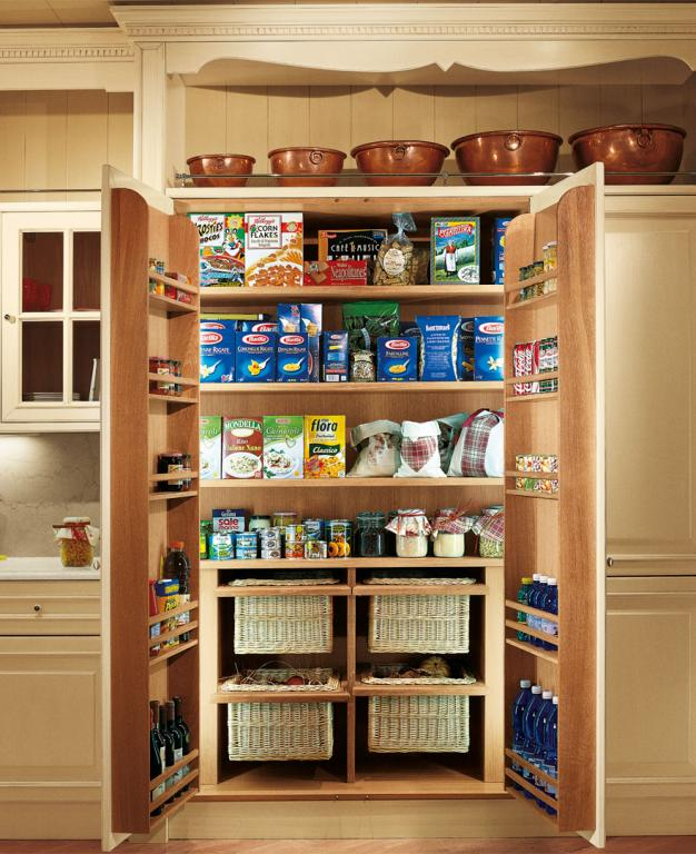 A spacious pantry with shelves and removable baskets