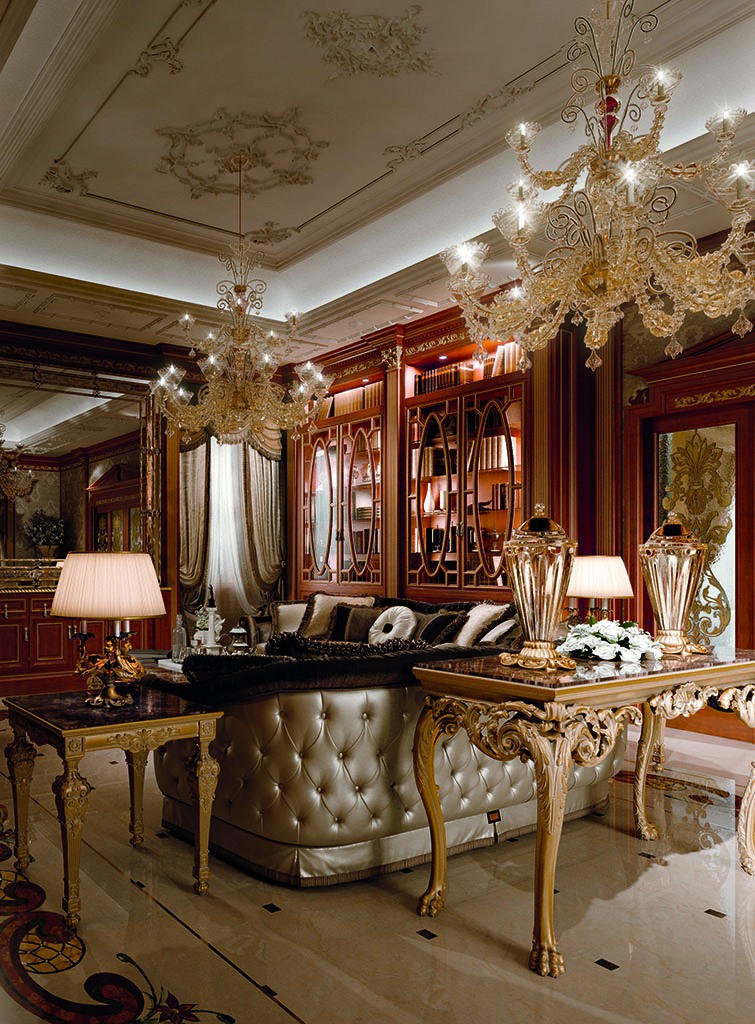 The living room is enhanced by the elegant glass cabinet along the wall and precious furnishing