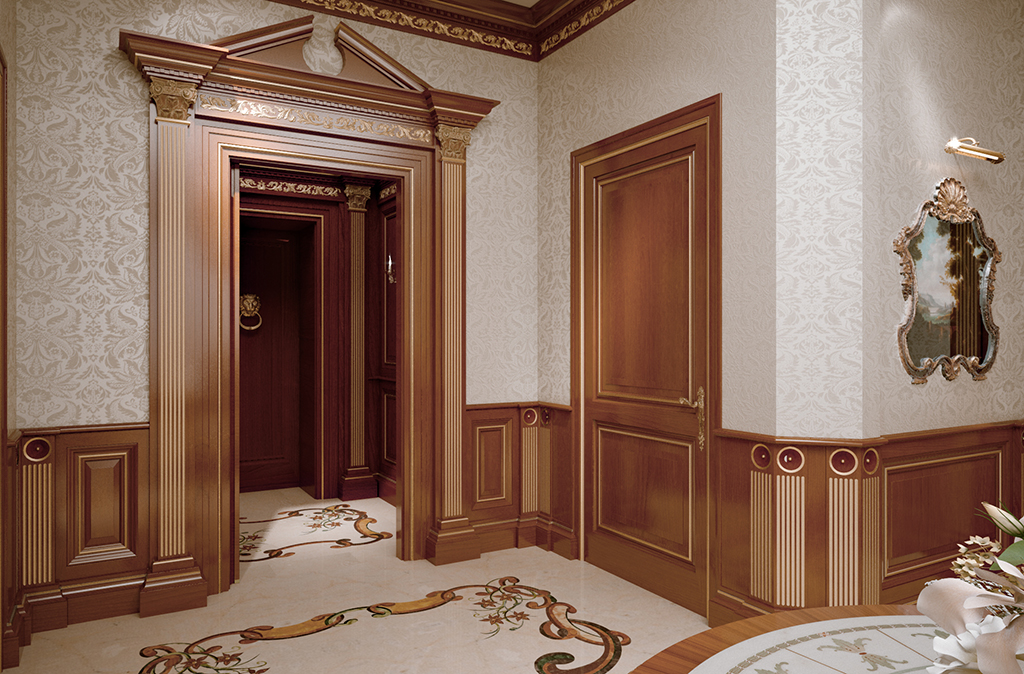 The paneling defines the entrance area integrating the access armored door, the portal of the hall and the door coordinated in the same style.