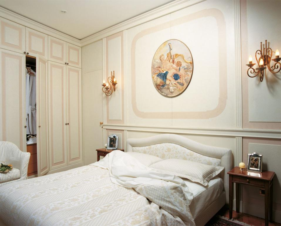 Modern two color hand sponged paneling for the bedroom