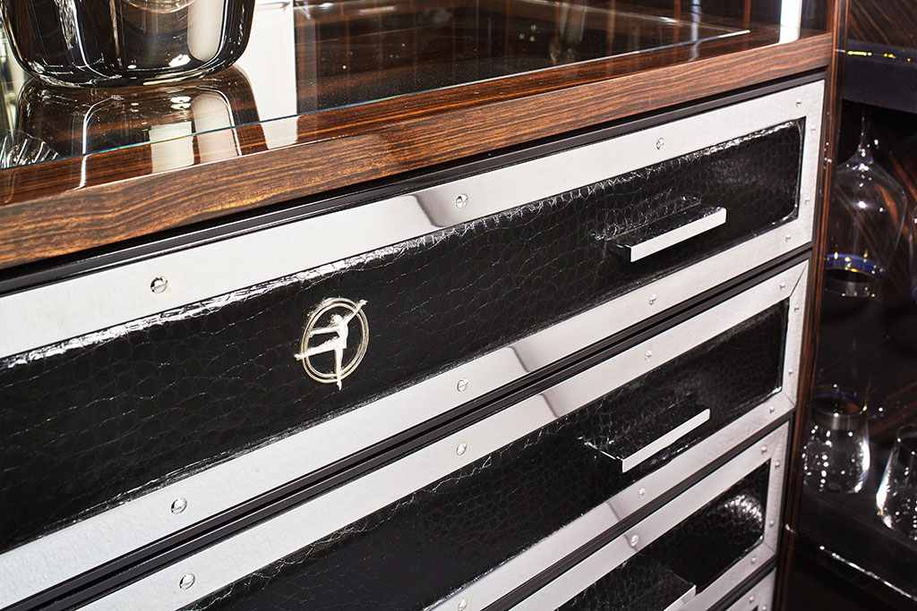 Drawers are embellished with steel edging and black leather