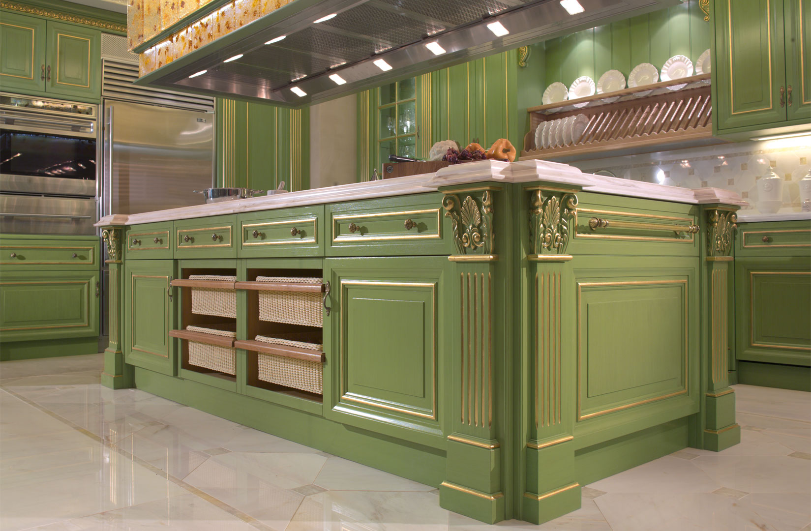A luxury kitchen with gold foil decorations and brass handles