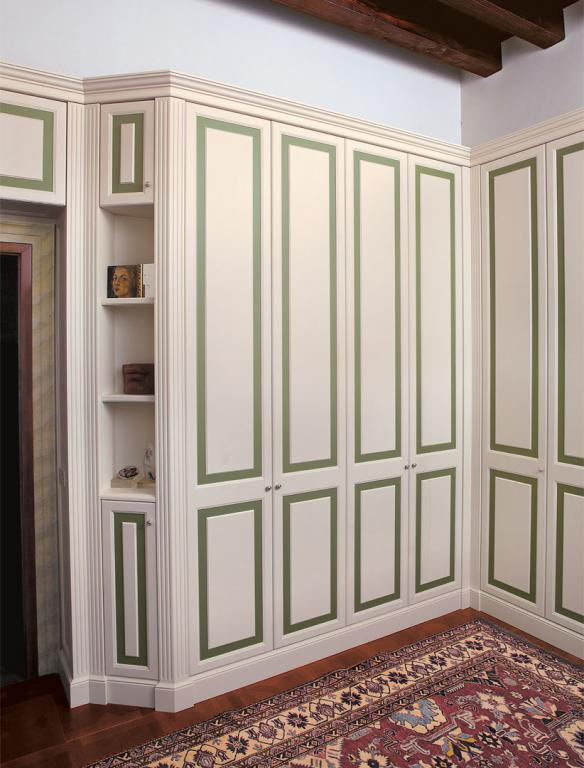 Custom made corner wardrobe, hand lacquered with contrasting inserts