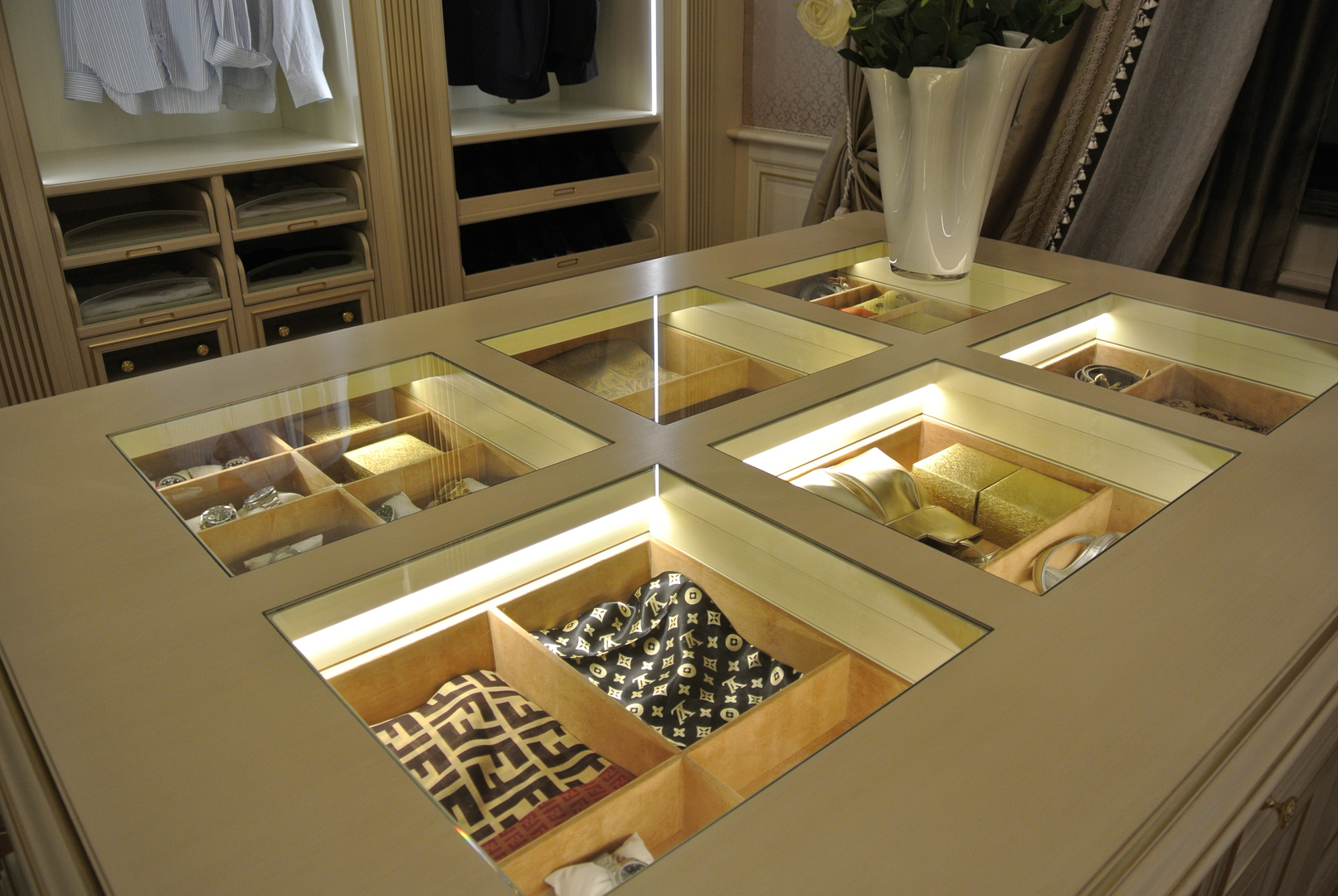 Particular view of the accessory drawers illuminated inside and trimmed with Alcantara.