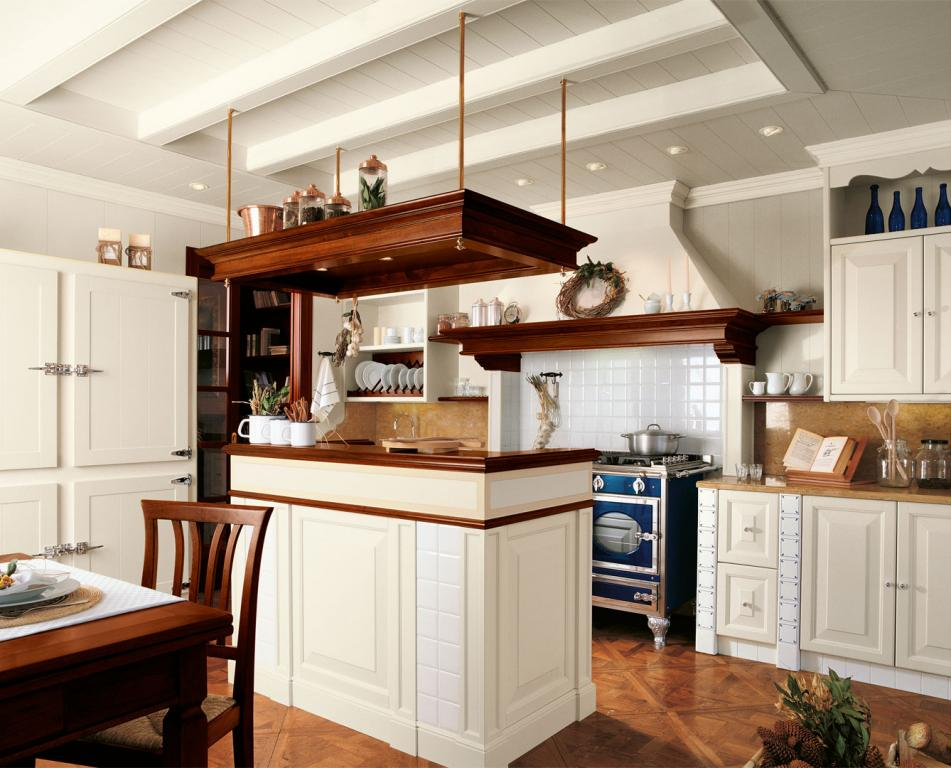 Both kitchen and ceiling are lacquered in European white with decorated ceramic inserts