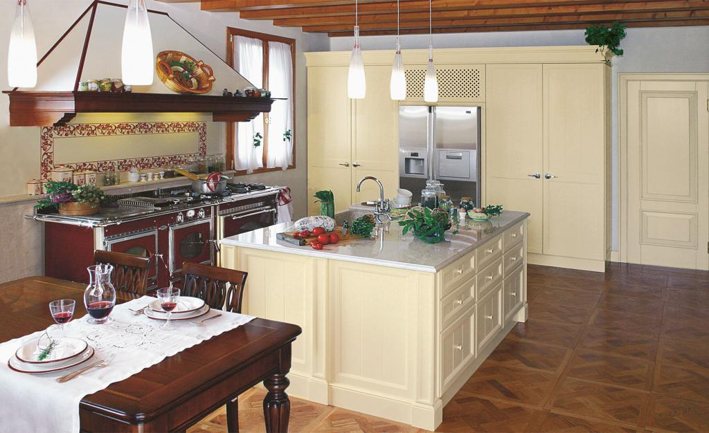 Central island with sink and spacious professional cooker