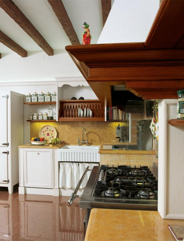 A professional cooker with an ample National walnut cooker hood
